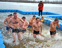 Man group running in cold water, Stock Images