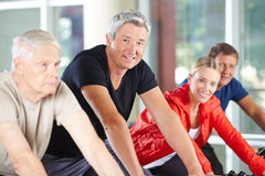 Man in group of seniors spinning in gym Royalty Free Stock Photo