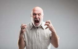 Angry old man getting crazy or a wolf Royalty Free Stock Photos