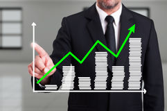 Man with growth chart business diagram on digital screen Stock Images