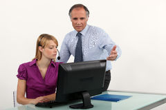 Man guiding his secretary Royalty Free Stock Photo