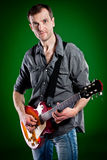 Man with a guitar Stock Image