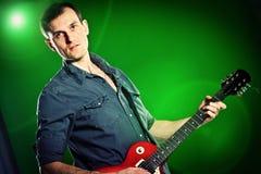 Man with a guitar Royalty Free Stock Photos