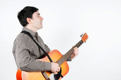A man with a guitar Stock Images