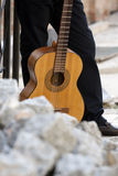 Man with guitar Stock Images