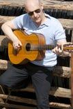 Man with guitar. Adult man playing guitar outdoors Stock Photo