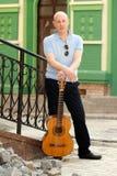 Man with guitar. Adult man playing guitar outdoors Stock Photos