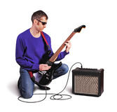 Man with guitar and amp isolated on white Stock Photography