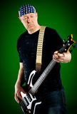 Man with a guitar, bass player Royalty Free Stock Image