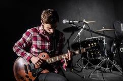 Man with guitar Stock Image