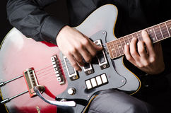 Man with guitar during concert Stock Photo
