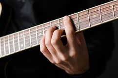 Man with guitar during concert Stock Image