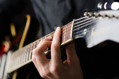 Man with guitar during concert Royalty Free Stock Photos