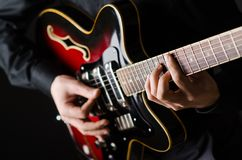 Man with the guitar during concert Royalty Free Stock Photos