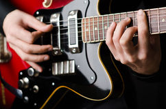 Man with the guitar during concert Royalty Free Stock Images