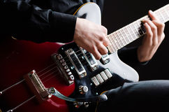 Man with guitar during concert Stock Photography