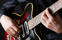Man with guitar during concert Royalty Free Stock Photography