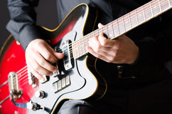 The man with guitar during concert Royalty Free Stock Images