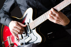 The man with guitar during concert Stock Images