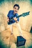 Man with a guitar . Royalty Free Stock Photos