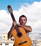 Man with a guitar. A handsome man with a guitar royalty free stock photos