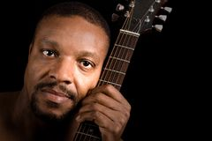 Man with guitar, headshot Royalty Free Stock Photography