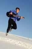 Man with guitar jumping Stock Photography
