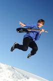 Man with guitar jumping Royalty Free Stock Images