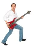 Man with guitar in move Royalty Free Stock Photo