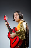 The man with guitar in musical concept Stock Photography