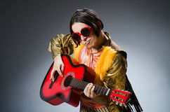 The man with guitar in musical concept Royalty Free Stock Photo