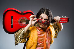 The man with guitar in musical concept Stock Photo