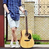Man with guitar outdoor portrait Stock Image