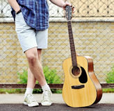 Man with guitar outdoor portrait Stock Photography