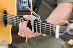 Man guitar player on acoustic guitar Royalty Free Stock Photography