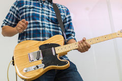Man guitar player on electric guitar telecaster Royalty Free Stock Photo