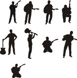 Man with guitar - silhouettes Royalty Free Stock Photo