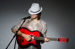 Man with guitar singing. With microphone Stock Photography