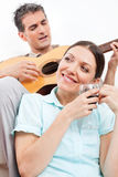 Man with guitar singing for woman Royalty Free Stock Photo