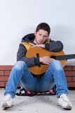 Man with guitar on the street Royalty Free Stock Photo