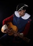 Man with a guitar (The troubadour),. The troubadour - portret of the photografer husband Royalty Free Stock Images