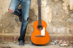 Man with guitar. urban style Stock Image