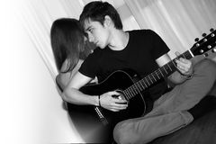 Man with guitar, woman Royalty Free Stock Image
