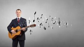 Man with guitar Stock Photos