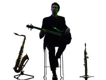 Man guitarist bassist  player playing silhouette Royalty Free Stock Photography