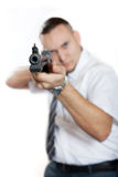 Man with gun. Businessman with gun is aiming. Focus on the barrel. White background Stock Image