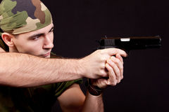 Man with gun. Soldiers,  on black background Stock Images