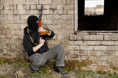 Man with gun. Man in mask with gun royalty free stock photos