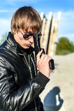 Man with gun. Portrait of man with a gun in glasses Stock Photography