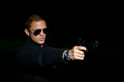 Man with gun. Portrait of young man with gun stock photography